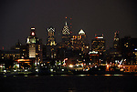 View of Philadelphia from Camden, NJ at night..Philadelphia, Pennsylvania, PA USA.  Photo copyright Lee Foster, 510-549-2202, lee@fostertravel.com, www.fostertravel.com.  Photo 281-30367