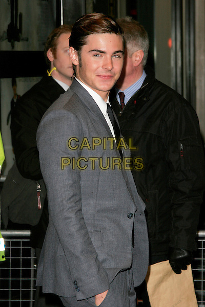 "ZAC EFRON.""17 Again"" UK film premiere at the Odeon West End cinema, London, England..March 26th, 2009.arrivals half length suit grey gray hand in pocket.CAP/AH.©Adam Houghton/Capital Pictures."