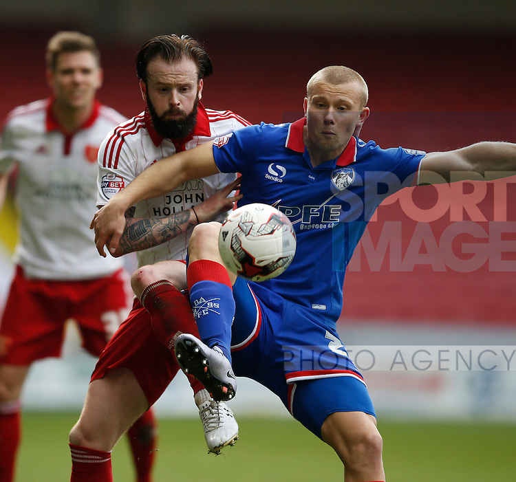 John Brayford of Sheffield Utd tackles Curtis Main of Oldham Athletic during the Sky Bet League One match at The Bramall Lane Stadium.  Photo credit should read: Simon Bellis/Sportimage