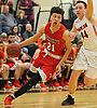 Sean Braithwaite #21 of Center Moriches, left, looks to drive to the net as Raymond Whittaker #44 of Babylon guards him during a Suffolk County League VII varsity boys basketball game at Babylon High School on Friday, Jan. 26, 2018. Center Moriches won by a score of 84-80.