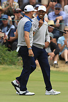 Tiger Woods (USA) and Justin Thomas (USA) on the 4th green during the Second Round - Foursomes of the Presidents Cup 2019, Royal Melbourne Golf Club, Melbourne, Victoria, Australia. 13/12/2019.<br /> Picture Thos Caffrey / Golffile.ie<br /> <br /> All photo usage must carry mandatory copyright credit (© Golffile | Thos Caffrey)