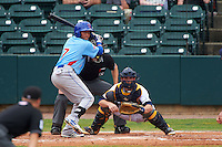 Tennessee Smokies shortstop Bryant Flete (7) at bat in front of catcher Justin O'Conner and umpire Alex Ransom during a game against the Montgomery Biscuits on May 25, 2015 at Riverwalk Stadium in Montgomery, Alabama.  Tennessee defeated Montgomery 6-3 as the game was called after eight innings due to rain.  (Mike Janes/Four Seam Images)