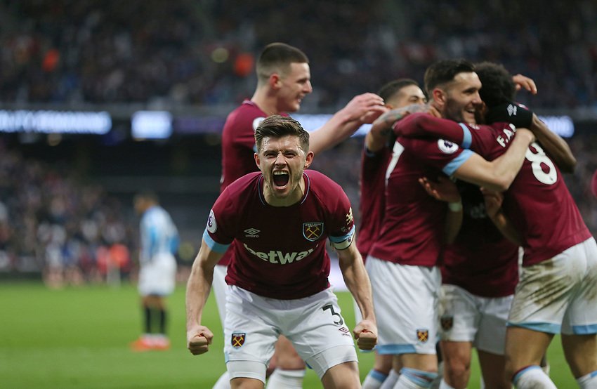 West Ham United's Aaron Cresswell celebrates after his side's fourth goal<br /> <br /> Photographer Rob Newell/CameraSport<br /> <br /> The Premier League - West Ham United v Huddersfield Town - Saturday 16th March 2019 - London Stadium - London<br /> <br /> World Copyright © 2019 CameraSport. All rights reserved. 43 Linden Ave. Countesthorpe. Leicester. England. LE8 5PG - Tel: +44 (0) 116 277 4147 - admin@camerasport.com - www.camerasport.com
