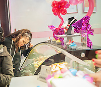 Customer at the Sprinkle Splash Sweet Shoppe, the newest addition to the shops located in La Marqueta in East Harlem in New York, seen on its opening day, Saturday, April 2, 2016. Besides the incubator kitchen in the building there are a number of retail spaces in the revitalized facility rented by the entrepreneurs and small businesses which use the kitchen. (© Richard B. Levine)