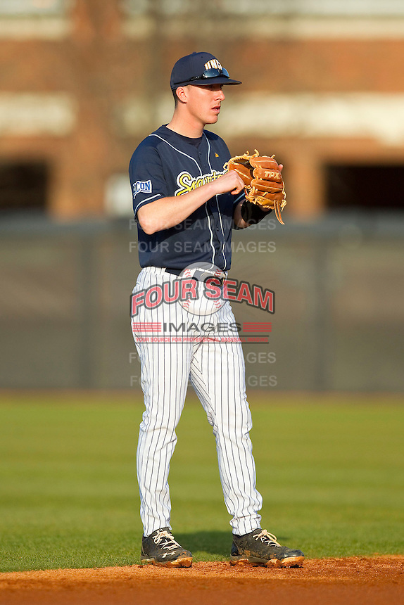 UNCG Spartans shortstop TJ Spina (9) on defense against the Georgia Southern Eagles at UNCG Baseball Stadium on March 29, 2013 in Greensboro, North Carolina.  The Spartans defeated the Eagles 5-4.  (Brian Westerholt/Four Seam Images)