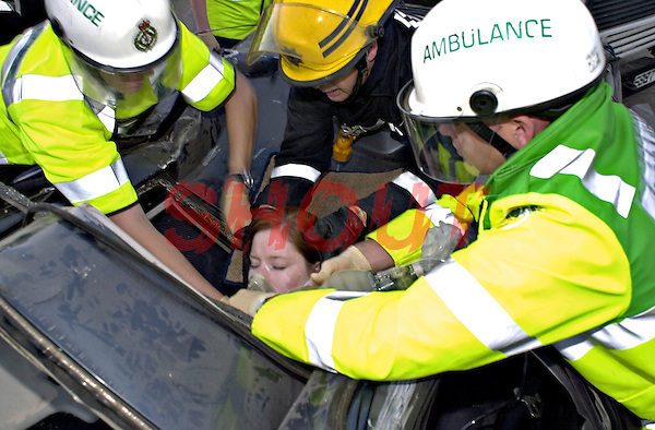 Firefighters and Paramedic crews attend a road traffic accident and work together to release the trapped driver. This image may only be used to portray the subject in a positive manner..©shoutpictures.com..john@shoutpictures.com