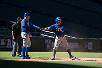 Freddy Fermin (54), of the Kansas City Royals, is congratulated by coach Scott Thorman (19) after sliding safely into third base during an Instructional League game against the Arizona Diamondbacks at Chase Field on October 14, 2017 in Scottsdale, Arizona. (Zachary Lucy/Four Seam Images)