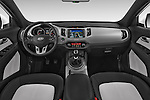 Stock photo of straight dashboard view of a 2014 KIA SPORTAGE Sense 5 Door SUV 2WD Dashboard