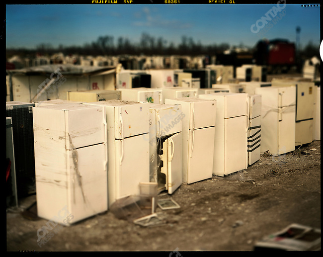 """At the large landfill and trash dump in St Bernard Parish, thosuands of """"White goods"""" - refrigerators, freezers, washers and dryers, that were destroyed in the hurricane are sorted, broken up and taken to the land fill. New Orleans, Louisina, January 2006"""