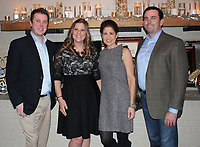 NWA Democrat-Gazette/CARIN SCHOPPMEYER Patrick Murphy (from left), Audre Darling and Angie and James Graves welcome guests to the 10th annual Oo! La, la! chocolate and wine tasting benefit for the Jackson L. Graves Foundation on Feb. 12 at The Garden Room in Fayetteville.