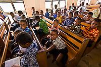 Fijian boys attending a Methodist church service in their village on Vatulele Island, Fiji Islands