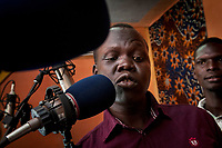 Eye Radio broadcaster CLEMENT LOBOI LOTIANG, recordS a radio commercial at a Juba station in South Sudan. In an effort to build up media and encourage a free media, USAID funded the station which is run by Internews.