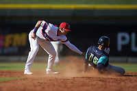 Will Benson (16) of the Lynchburg Hillcats slides into second base ahead of the tag by Mitch Roman (16) of the Winston-Salem Rayados at BB&T Ballpark on June 23, 2019 in Winston-Salem, North Carolina. The Hillcats defeated the Rayados 12-9 in 11 innings. (Brian Westerholt/Four Seam Images)