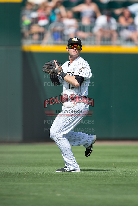 Charlotte Knights shortstop Andy Parrino (12) makes a catch in shallow left field during the game against the Indianapolis Indians at BB&T BallPark on June 19, 2016 in Charlotte, North Carolina.  The Indians defeated the Knights 6-3.  (Brian Westerholt/Four Seam Images)