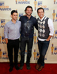 UNIVERSAL CITY, CA. - May 31: Actors Ed Helms, Justin Bartha and Bradley Cooper arrive at the 2009 MTV Movie Awards held at the Gibson Amphitheatre on May 31, 2009 in Universal City, California.