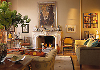 A sitting room in predominately neutral tones with a mix of modern and traditional styles. A patterned sofa faces an ornate fireplace with a lit fire.