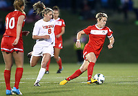 BOYDS, MARYLAND - April 06, 2013:  Lori Lindsey (6) of The Washington Spirit turns away from Morgan Brian (6) of the University of Virginia women's soccer team in a NWSL (National Women's Soccer League) pre season exhibition game at Maryland Soccerplex in Boyds, Maryland on April 06. Virginia won 6-3.