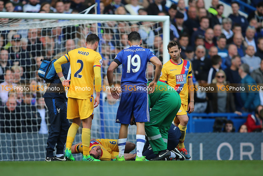 Scott Dann of Crystal Palace is injured and leaves the pitch during Chelsea vs Crystal Palace, Premier League Football at Stamford Bridge on 1st April 2017