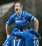 St Johnstone v Dundee United.....29.12.13   SPFL<br /> Frazer Wright jumps on Stevie May after he scored his second goal<br /> Picture by Graeme Hart.<br /> Copyright Perthshire Picture Agency<br /> Tel: 01738 623350  Mobile: 07990 594431
