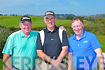 Eamon O'Connor, Martin Downey and Con O'Connor driving off at the Castleisland Golf Course classic on Saturday