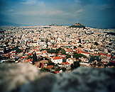 GREECE, Athens, elevated view of the city from the Acropolis with Mount Lycabettos and the neighborhood of Kolonaki in the distance