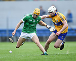 Darren O Connell of Limerick in action against Ross Hayes of Clare during their Munster U-21 hurling quarter final at Cusack park. Photograph by John Kelly.