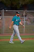 AZL Mariners manager Zac Livingston (15) walks toward the mound during an Arizona League game against the AZL Giants Orange on July 18, 2019 at the Giants Baseball Complex in Scottsdale, Arizona. The AZL Giants Orange defeated the AZL Mariners 7-4. (Zachary Lucy/Four Seam Images)