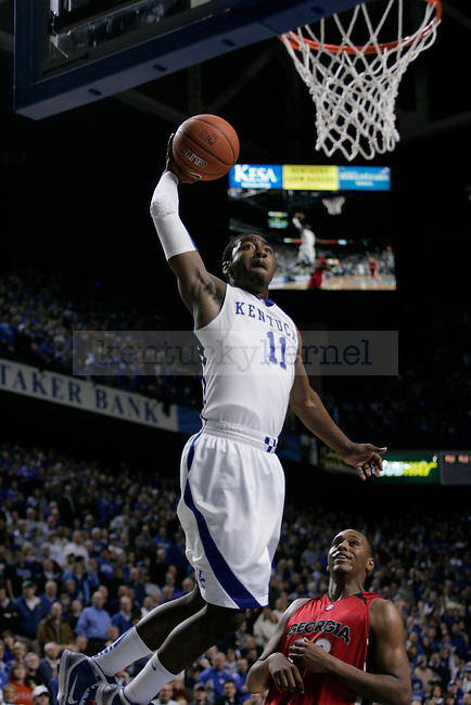 Freshman guard John Wall makes a dunk in the last few seconds of the UK men's basketball game against Georgia at Rupp Arena on Saturday, Jan. 9, 2010. The Cats beat the Bulldogs 76-68. Photo by Adam Wolffbrandt | Staff