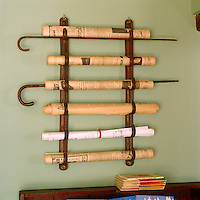 In the entrance hall walking sticks and rolled newspapers share the same antique leather rack