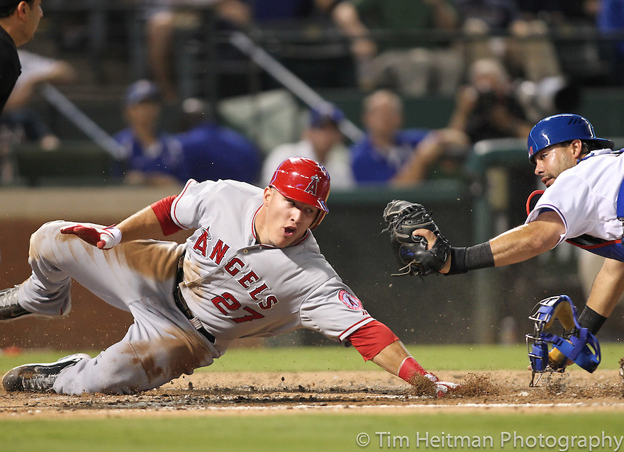 Sep 28, 2012; Arlington, TX, USA; Los Angeles Angels center fielder Mike Trout (27) is tagged out at home plate as he attempts to score by Texas Rangers catcher Geovany Soto (8) in the third inning at Rangers Ballpark. Mandatory Credit: Tim Heitman-US PRESSWIRE