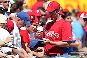 Philadelphia Phillies Roy Oswalt #44 signs autographs before a spring training game against the Baltimore Orioles at Bright House Field in Clearwater, Florida;  March 8, 2011.  Photo By Mike Janes/Four Seam Images