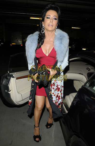 Nancy Dell'Olio.The Terrence Higgins Trust: Friends For Life charity dinner, Park Lane Hotel, Piccadilly, London, England..June 14th, 2012.full length black suit red dress blue fur wrap cleavage car funny clutch bag  .CAP/CAN.©Can Nguyen/Capital Pictures.