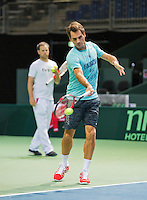 Switserland, Genève, September 17, 2015, Tennis,   Davis Cup, Switserland-Netherlands, Roger Federer practise, in the background captain Severin Luthi<br /> Photo: Tennisimages/Henk Koster