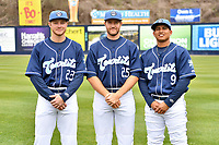 Asheville Tourists catchers (L-R) Willie Maclver (23) Greg Jones (25) and Javier Guevara (9) during media day at McCormick Field on April 2, 2019 in Asheville, North Carolina. (Tony Farlow/Four Seam Images)
