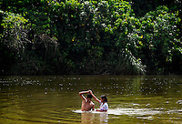 Rene Uribe, left, and his girldfriend Vania Excalera dance in a river during a hot afternoon in Eterezama, Bolivia.