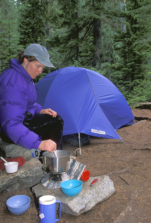 Woman cooking in camp, Mount Rainier National Park, Washington