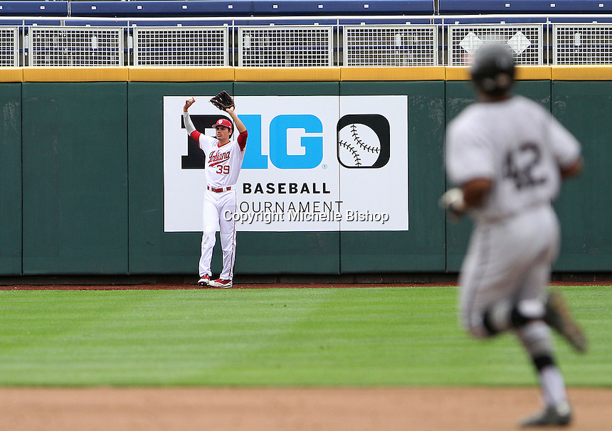 Craig Dedelow (39) signals to the umpires after a ball hit by Maryland's Marty Costes (42) bounced into the stands for a ground rule double. The Hoosiers lost 5-3 to Maryland in the opening game of the Big Ten Tournament at TD Ameritrade Park in Omaha, Neb. on May 25, 2016. (Photo by Michelle Bishop)