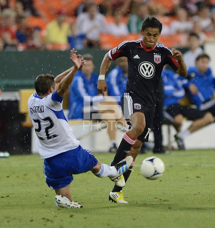 Andy Najar (14) of D.C. United is fouled by Davy Arnaud (22) of the Montreal Impact during the game at RFK Stadium in Washington DC.   D.C. United defeated the Montreal Impact, 3-0.