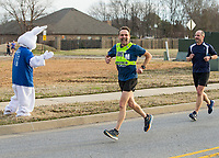NWA Democrat-Gazette/BEN GOFF @NWABENGOFF<br /> Volunteers from Flagstone Church of Christ in Bentonville support runners at an aid station Saturday, March 23, 2019, during a half marathon training run at Memorial Park in Bentonville. The group set up the aid station as participants in the Run Bentonville Half Marathon training program took their final group run before the March 30 half marathon. The training program, run by Mike Rush of Rush Running Company, has been preparing runners with clinics and group runs since December. Flagstone Church of Christ was also promoting their Jack Rabbit 5K, set for April 13, which works with Rush Running Company to donate shoes to local families in need.