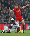 Victor Anichebe of Sunderland  tussles with Jordan Henderson of Liverpool during the Premier League match at the Anfield Stadium, Liverpool. Picture date: November 26th, 2016. Pic Simon Bellis/Sportimage