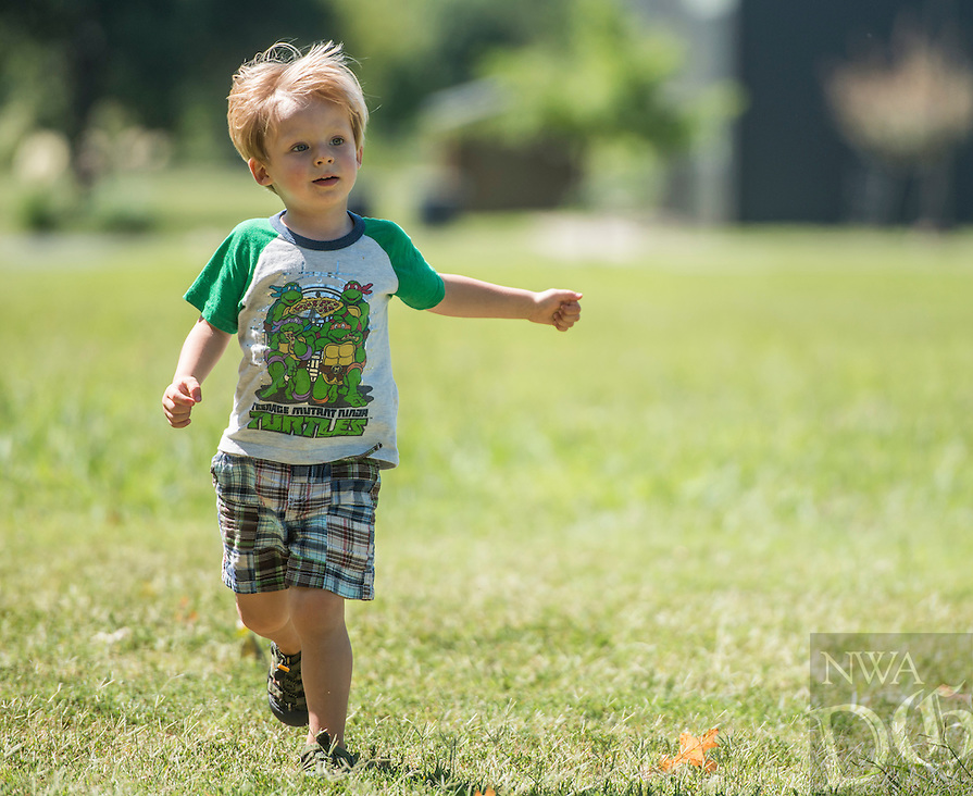 NWA Democrat-Gazette/ANTHONY REYES &bull; @NWATONYR<br /> Russell Conn, 2, of Gravette, plays in a field Friday Sept. 2, 2016 near Tyson Sports Complex in Springdale. Russell played in the field with friends after a picnic lunch with their mothers on a pleasant afternoon.