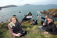 2-3-2011 DINGLE: Fiona Griffin (The Director) leads her film crew Maurice Galwey, Nigel Cole and David Chippendale as they film a 'Naomhog' on Dun Chaoin pier on Slea Head County Kerry at the launch on Wednesday  of the Dingle Film Festival which takes place from March 17-20th. This years recipient of the Gregory Peck Award for contribution to film is French Director Jean Jaques Beineix famed for 'Betty Blue' and many more movies.<br /> Picture by Don MacMonagle