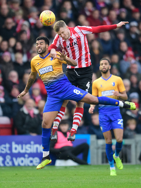 Lincoln City's Michael O'Connor vies for possession with Mansfield Town's Jacob Mellis<br /> <br /> Photographer Chris Vaughan/CameraSport<br /> <br /> The EFL Sky Bet League Two - Lincoln City v Mansfield Town - Saturday 24th November 2018 - Sincil Bank - Lincoln<br /> <br /> World Copyright © 2018 CameraSport. All rights reserved. 43 Linden Ave. Countesthorpe. Leicester. England. LE8 5PG - Tel: +44 (0) 116 277 4147 - admin@camerasport.com - www.camerasport.com