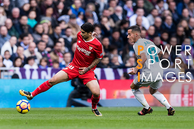 Lucas Vazquez of Real Madrid (R) in action against Ever Banega of Sevilla FC (L) during the La Liga 2017-18 match between Real Madrid and Sevilla FC at Santiago Bernabeu Stadium on 09 December 2017 in Madrid, Spain. Photo by Diego Souto / Power Sport Images