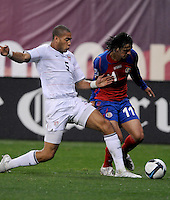 USMNT defender Oguchi Onyewu (5) defends the play against Costa Rica forward Bryan Ruiz (11)  The USMNT tied Costa Rica 2-2 on the final game of the 2010  FIFA World Cup Qualifying round at RFK Stadium,Wednesday  October 14 , 2009.