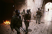 Jerusalem, Israel<br /> January 15, 1988<br /> <br /> More then 1,000 Israeli soldiers surround and enter the Dome of the Rock as Palestinians shout anti-Israeli slogans and burn Israeli and American flags after Friday ceremonies. Israel soldiers shoot tear gas into the Dome as young Palestinians throw rocks at the soldiers. Several police and at least 70 Palestinians are injured as the Israelis beat Palestinians with clubs during the 1 hour ordeal.