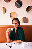 RUSSIA, Moscow. Young woman having espresso at Bontempi Restaurant.