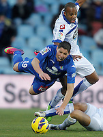 Getafe's Abdel Barrada against Deportivo de La Coruna's Evaldo Fabiano during La Liga match. February 01, 2013. (ALTERPHOTOS/Alvaro Hernandez) /NortePhoto