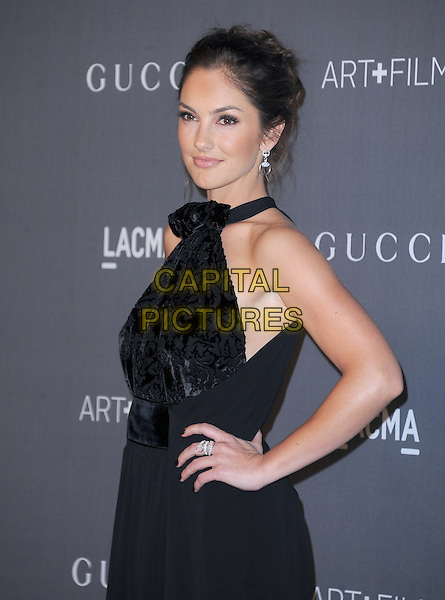 Minka Kelly.at The LACMA 2012 Art and Film Gala held at LACMA in Los Angeles, California, USA, October 27th 2012..half length hand on hip dress side black high neck patterned halterneck earrings hair up beauty .CAP/RKE/DVS.©DVS/RockinExposures/Capital Pictures.