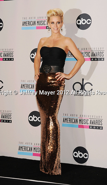 LOS ANGELES, CA - NOVEMBER 18: Jenny McCarthy   poses in the press room at the 40th Anniversary American Music Awards held at Nokia Theatre L.A. Live on November 18, 2012 in Los Angeles, California.